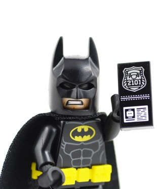 An off-duty cop dressed as Batman at a Walmart stopped a man who tried to leave the store without paying for several DVDs, including the Lego Batman Movie!